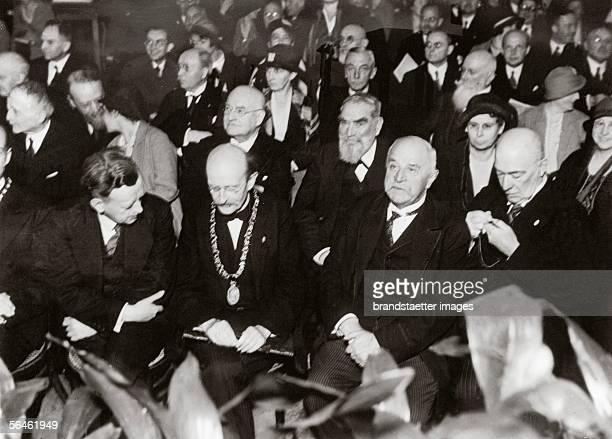 German physicist Max Planck at the 21st general meeting of the KaiserWilhelmGesellschaft Behind him Carl Duisberg german chemist and industrial...
