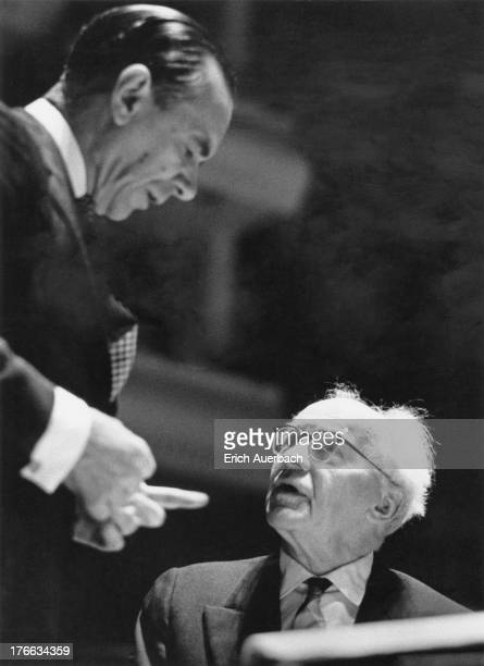 German pianist Wilhelm Backhaus and Sir John Barbirolli discuss the score during rehearsal for a concert with the Halle Orchestra at the Royal...