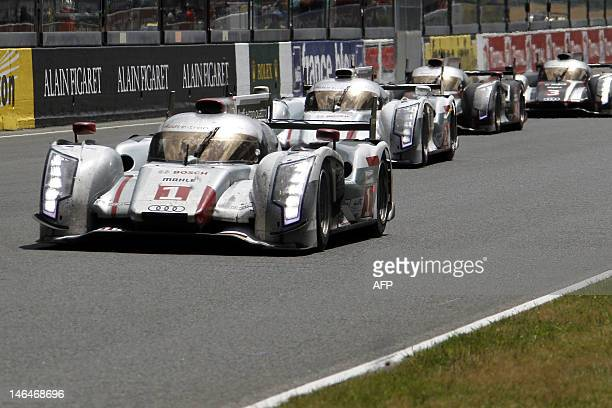 German pilot Andre Lotterer and his Audi R18 ETron Quattro N°1 is leading the race one lap before the end of its 378th in front of Audi R18 ETron...