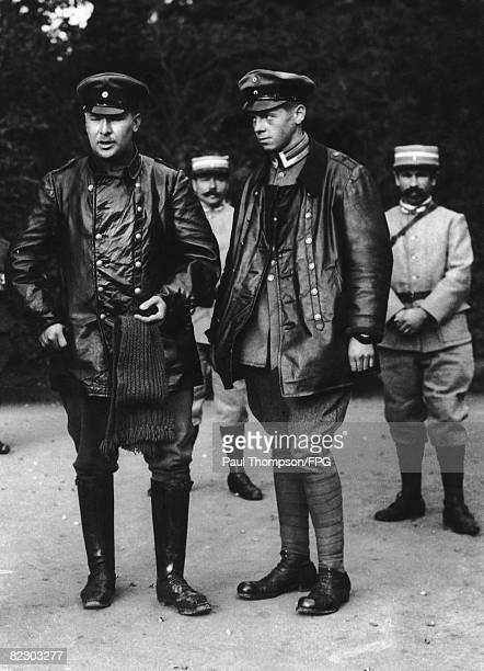 German pilots captured by the French during World War I are brought in for interrogation circa 1916