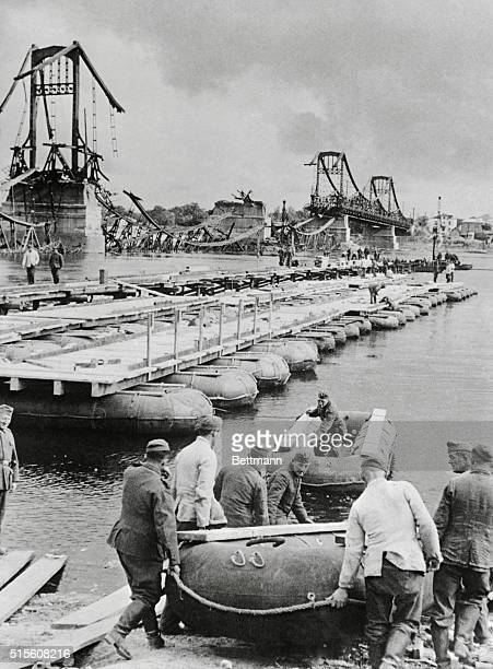 """German """"pioneer"""" troops complete a pontoon bridge over the Dnieper River """"somewhere in Russia,"""" after old bridge was destroyed by Russians. The..."""