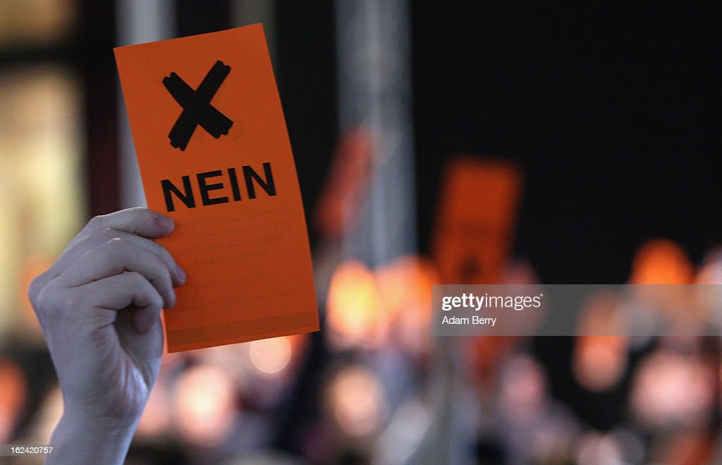 A German Pirate Party supporter holds up a card to signify a 'no' vote during a meeting of the Berlin chapter of the party on February 23, 2013 in Berlin, Germany. After successes in 2011 in regional elections in the German capital and in the following year in the states of Schleswig-Holstein and North Rhine-Westphalia, the German Pirate Party (Piratenpartei), which initially focused on filesharing, censorship and data protection, has seen two of its state-level leaders in the states of Brandenburg and Baden-Wuerttemburg step down in the past few days alone. The party's Berlin representation is meeting over the weekend to choose its candidates for the country's federal elections, to be held on September 22, 2013, which will determine the 598 or more members of the 18th Bundestag, Germany's federal parliament. After well-publicized infighting in the party, many observers are skeptical that the party can reach the 5 percent vote required to join the country's politics on that level.
