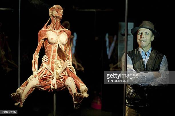 German plastinator Gunther von Hagens poses for photographs during a press conference as he unveils his new sex plastinates for his Body Worlds...