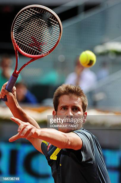 German player Florian Mayer returns the ball to British player Andy Murray during their tennis match at the Madrid Masters at the Magic Box sports...