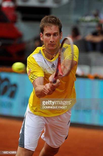 German player Florian Mayer returns the ball to British player Andy Murray during their match at the Madrid Masters at the Magic Box sports complex...