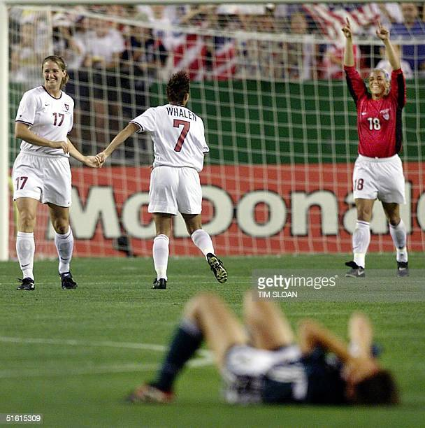 German player lies on the ground as US Women's World Cup soccer team members Danielle Fotopoulos Sara Whalen and Saskia Webber celebrate their win in...