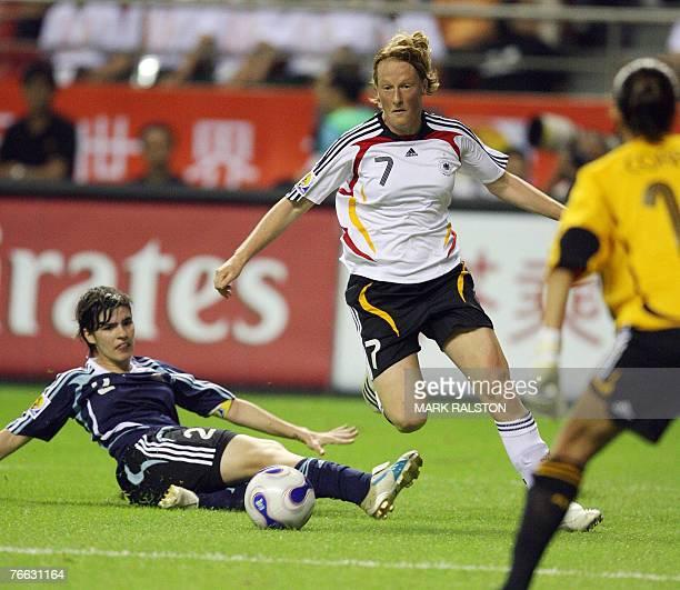 German player Melanie Behringer beats Argentinian defender Eva Gonzalez before scoring during their 2007 FIFA Women's World Cup football tournament...