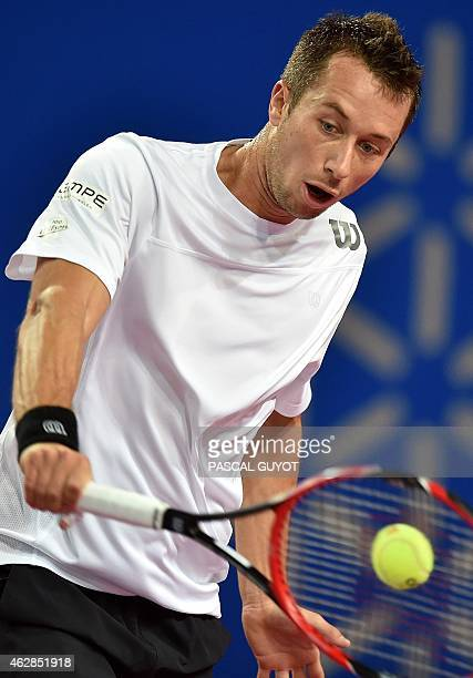German player Philipp Kohlschreiber returns the ball to Portuguese player Joao Sousa during their tennis match at the Open Sud de France world tour...