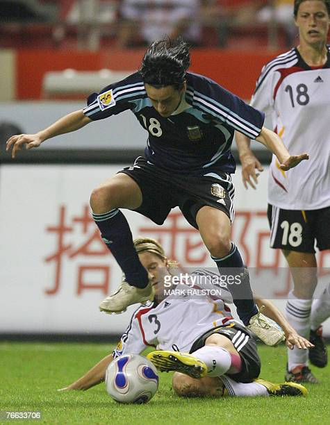 German player Saskia Bartusiak tackles Maria Potassa from Argentina as Kerstin Garekfrekes from Germany looks on during their opening 2007 FIFA...