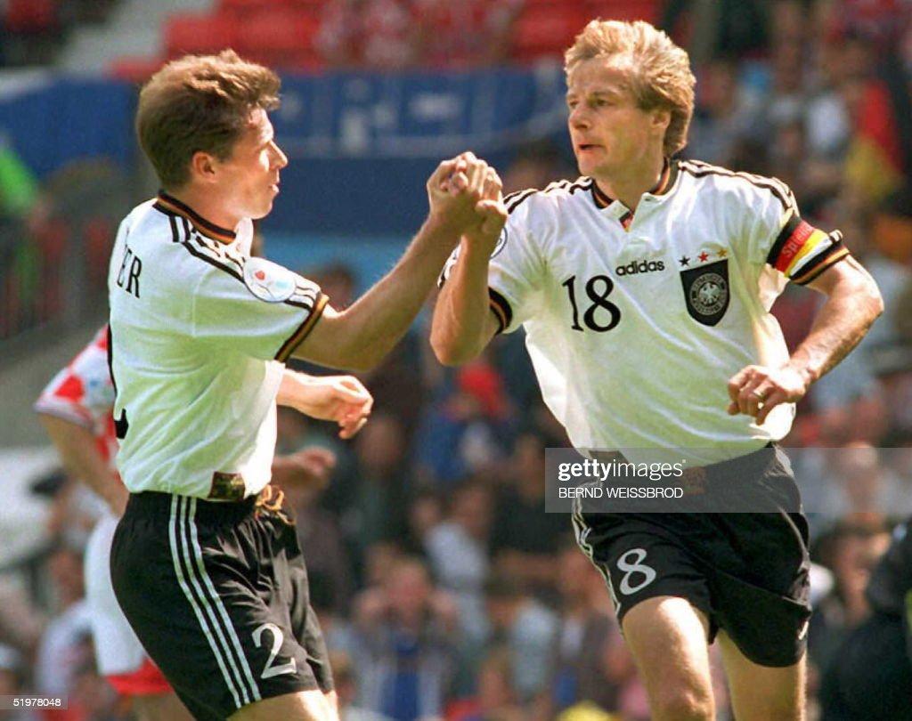 German player Stefan Reuter (L) congratulates capt : News Photo