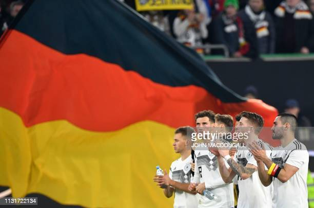 German players applaud their fans after the friendly football match Germany v Serbia in Wolfsburg, western Germany on March 20, 2019. / RESTRICTIONS:...