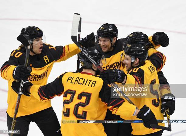 TOPSHOT German players celebrate a goal in the men's semifinal ice hockey match between Canada and Germany during the Pyeongchang 2018 Winter Olympic...