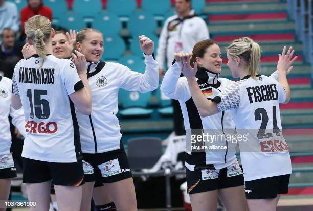 German players celebrate after a handball match between Germany and the DR Congo at the IHF Women's Handball World Championship in Kolding, Denmark,...