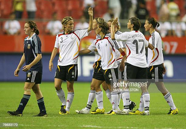 German players celebrate after beating Argentina during their opening 2007 FIFA Women's World Cup football tournament Group A match against Argentina...