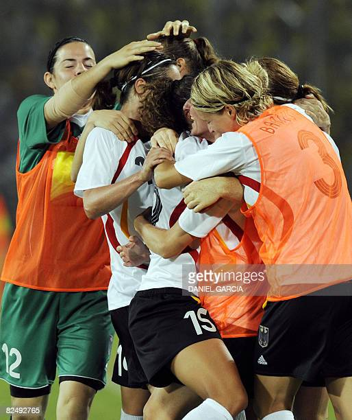 German players celebrate after Fiirtme Bajramaj scored a goal against Japan during the 2008 Beijing Olympic Games women's football bronze medal match...