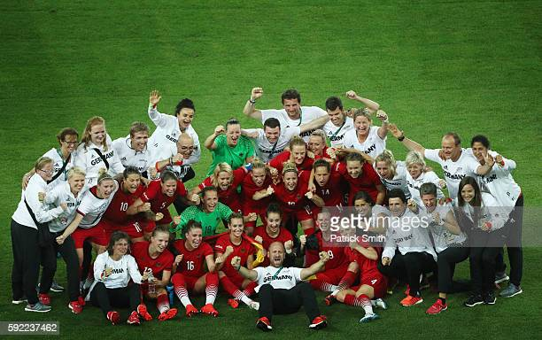 German players celebrate after the final whistle following victory during the Women's Olympic Gold Medal match between Sweden and Germany at Maracana...