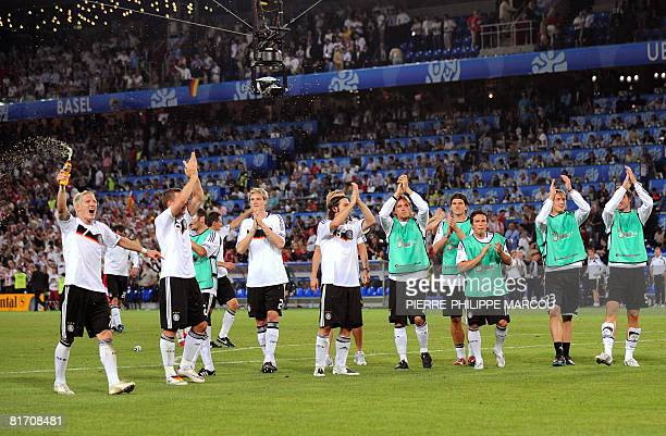 German players celebrate at the end of the Euro 2008 championships semifinal football match Germany vs Turkey on June 25 2008 at St JakobPark stadium...