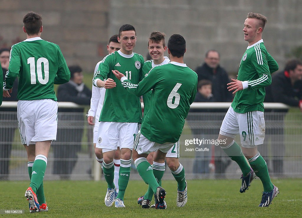 German players celebrate the goal of Oguzhan Aydogan (11) during the Tournament of Montaigu qualifier match between U16 Germany and U16 England at the Stade Saint Andre D'Ornay on March 30, 2013 in La Roche-sur-Yon, France.