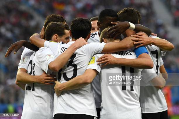 TOPSHOT German players celebrate the team's the first goal during the 2017 Confederations Cup final football match between Chile and Germany at the...
