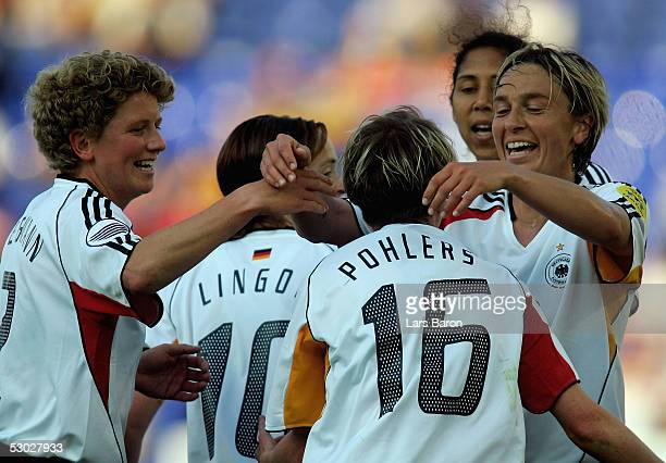 German players celebrate the winning goal from Conny Pohlers during the UEFA Women's Championship group B preliminary match between Germany and...