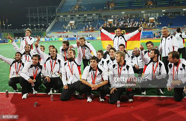 German players celebrate with their country's flag after winning the Men's Gold Medal Match between Germany and Spain held at the Olympic Green...