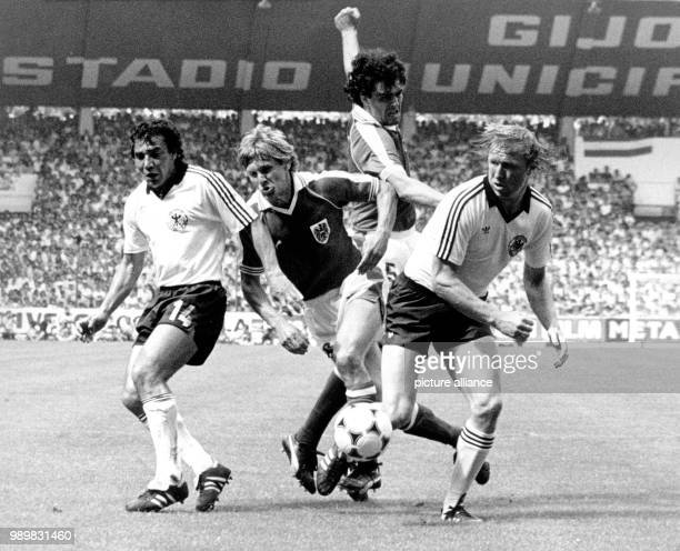 German players Felix Magath and Horst Hrubesch fight for the ball with Austrians Roland Hattenberger and Bruno Pezzey during the 1982 World Cup group...
