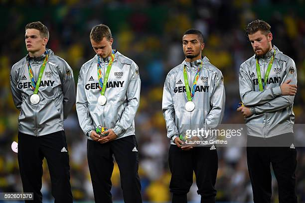 German players look dejected after losing in the Men's Football Final between Brazil and Germany at the Maracana Stadium on Day 15 of the Rio 2016...