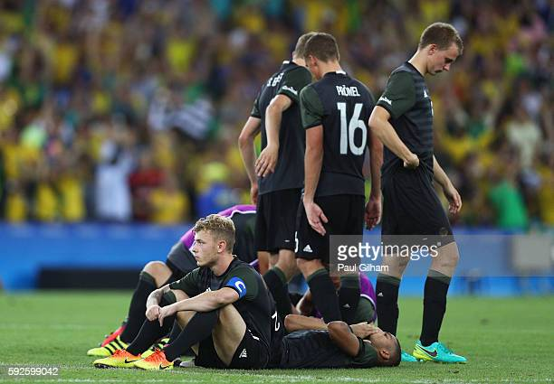 German players look dejected after losing in the penalty shoot out during the Men's Football Final between Brazil and Germany at the Maracana Stadium...