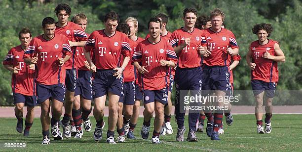 German players of Bayern Munich jog during a training session in Dubai 10 January 2004 The German champions Bayern Munich will travel to Premiership...