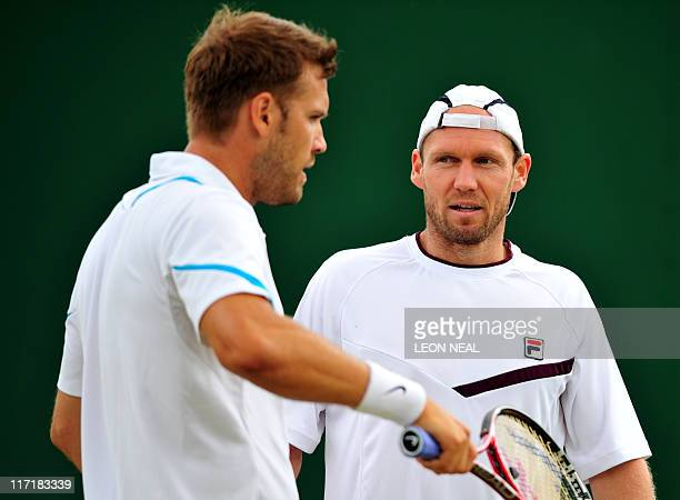 German players Rainer Schuettler and Alexander Waske are seen as they play against Indian player Somdev Devvarman and Japanese player Kei Nishikori...