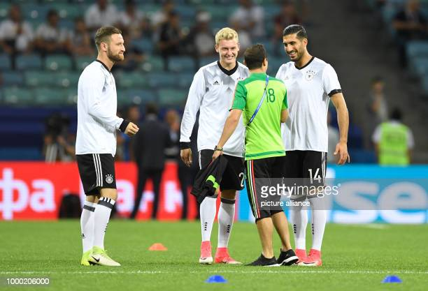 German players Shkodran Mustafi Julian Brandt and Emre Can as well as Andres Guardado from Mexico can be seen before the start of the semifinal of...