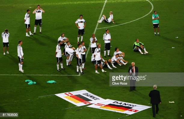 German players stand next to big signs reading 'Thank You' following the team's loss against Spain in the UEFA EURO 2008 Final match between Germany...
