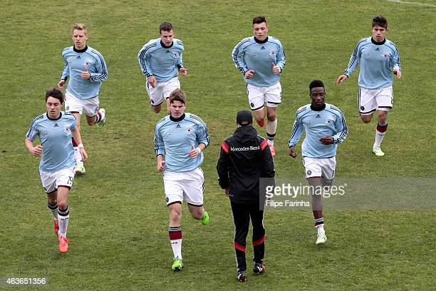 German players warm up before the kickoff during the U16 UEFA development tournament between Germany and Netherlands on February 16 2015 in Vila Real...