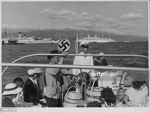 A German pleasure boat flying a Nazi flag off the coast of Kingston Jamaica circa 19301940
