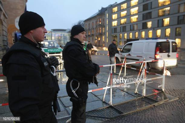 German police armed with submachine guns check vehicles arriving at the eastern entrance of the Reichstag seat of the Bundestag or German parliament...