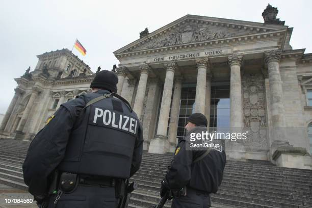 German police armed with submachine guns patrol next to the Reichstag seat of the Bundestag or German parliament on the day Bundestag members began...