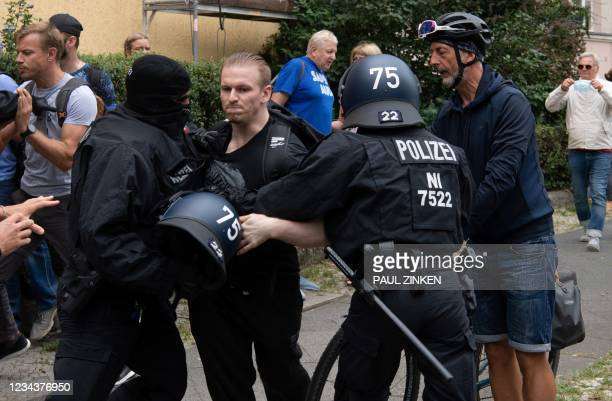 German police arrest a participant of an anti-lockdown protest in Berlin on August 1, 2021. - Berlin police clashed with Covid sceptics on August 1...