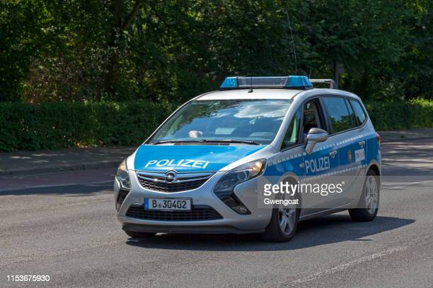 german police car in berlin - gwengoat stock pictures, royalty-free photos & images