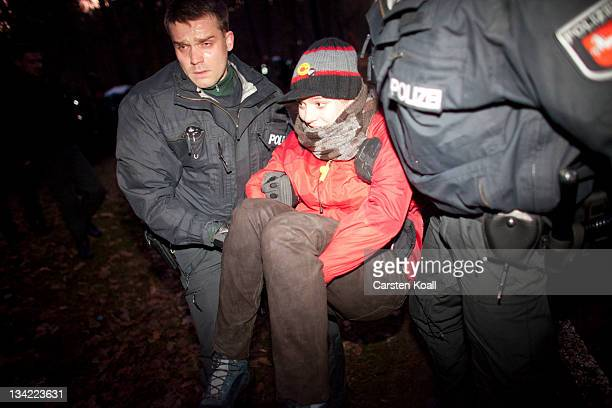 German police carry antinuclear protesters after a sitin attempt on a road to block a convoy of trucks transporting containers with nuclear waste on...