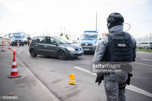 German police control vehicles at the border between France and Germany in Kehl on December 13, 2018 after a gunman killed at least three people and...