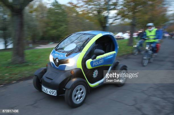 German police drive a Renault Twizy electric city car through a park near the venue of the COP 23 United Nations Climate Change Conference on...