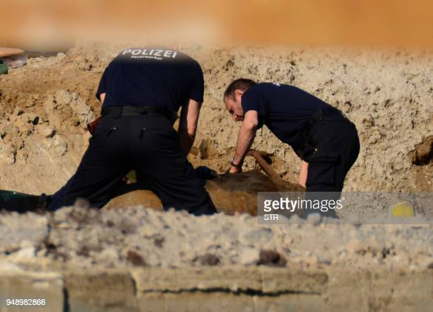 TOPSHOT German police experts work during the disposal operations of a bomb dropped during World War II on April 20 2018 near the Hauptbahnhof main...