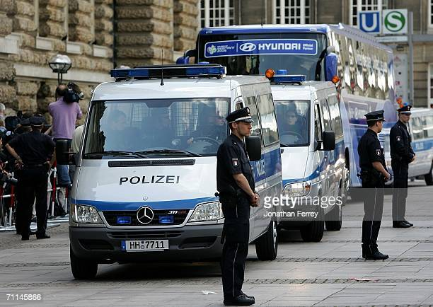German police guard the transport bus of the United States National Team as they are officially welcomed by Hamburg mayor Ole von Buest at the Town...