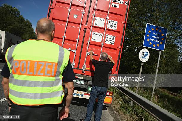 German police inspect a truck entering Germany at the border to Austria on September 15 2015 near Freilassing Germany German authorities have...