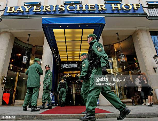 German police men walk past the Hotel Bayerischer Hof during the first day of the Munich conference on security policy on February 6 2009 in Munich...