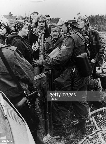 A German police officer faces antinuclear waste demonstrators at a borehole in Gorleben West Germany