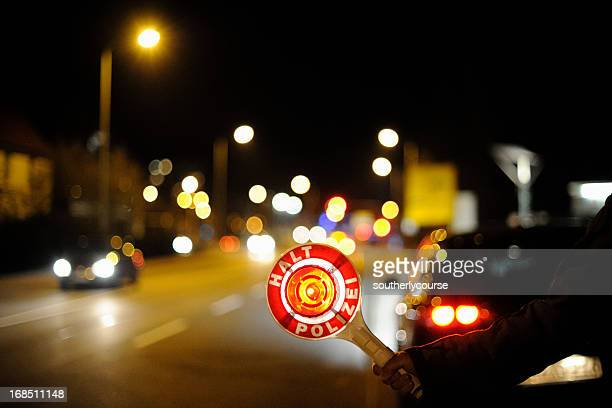 German Police Officer Stopping Traffic at Night