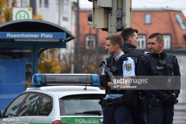 German police officers stand guard near Rosenheimer square after a man attacked passersby on October 21, 2017 in the southern German city of Munich....