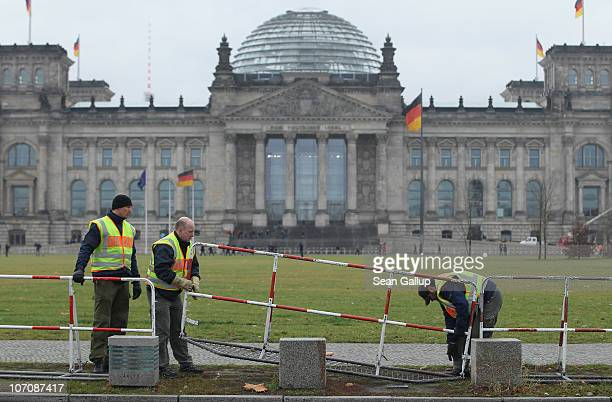 German police set up barricades in an outoftheordinary measure near the Reichstag seat of the Bundestag or German parliament along a road that leads...
