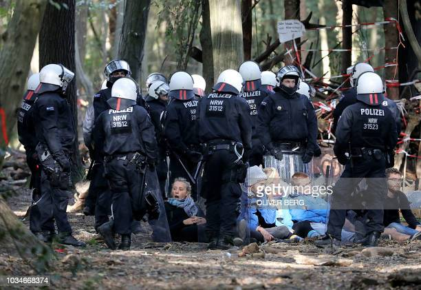 German police surround protesters during the evacuation operations of a camp of environmentalists set up to protest against the deforestation of...
